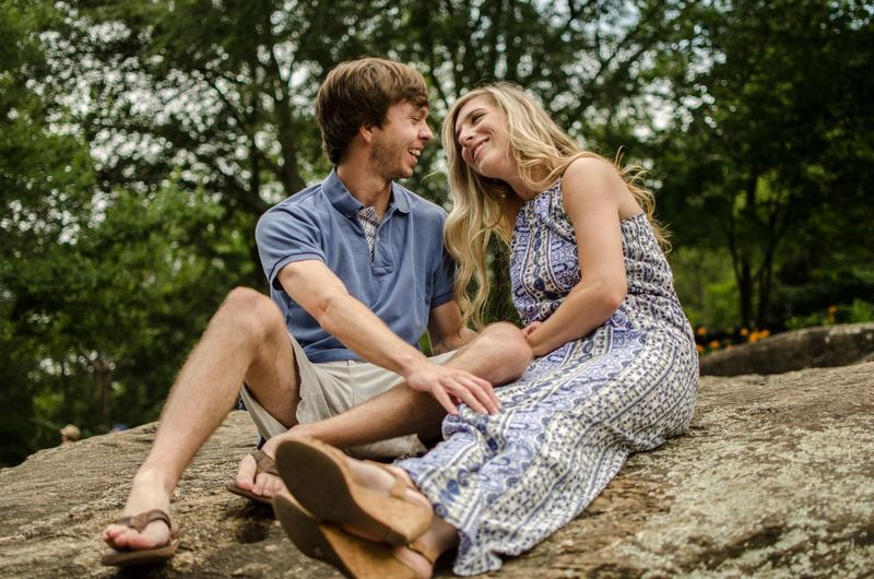 EyeEm Selects EyeEm Selects Sitting Two People Togetherness Love Men Heterosexual Couple Smiling Mature Adult Mature Men Happiness People Adult Day Casual Clothing Bonding Outdoors Adults Only Full Length Cheerful Tree Love Romantic Low Angle View
