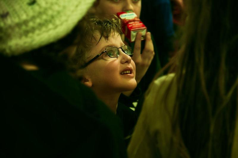 Close-up of cute boy looking away in darkroom