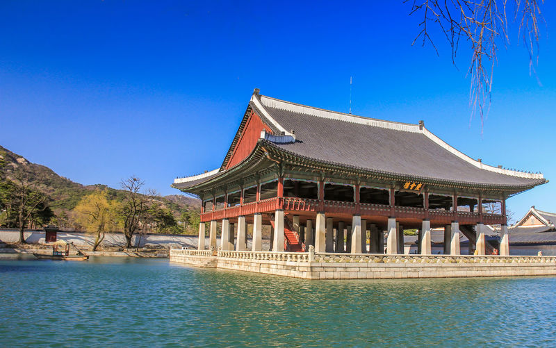 Grand Pavilion in Seoul Palace Korea Pavilion Grand Pavilion Pavilion Seoul Seoul Seoul, Korea Seoul Panorama Seoul Palace Built Structure Architecture Water Building Exterior Sky Nature Tree Blue Clear Sky Day No People Building Waterfront Plant Roof Travel Destinations Sunlight Outdoors Religion