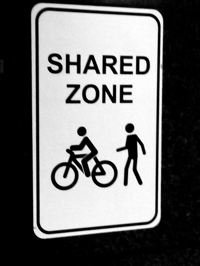 Reflective Signs Illuminatedsigns CapitalLetters CAPITAL LETTERS. Bicycle Symbol Pedestrian Traffic Sign Road Sign Male Likeness Sharing  SharedZone Share Shared Zone Human Representation Two People Sign Signs, Signs, & More Signs Black And White Blackandwhite Signs & More Signs Illuminated Signs Bicycle Notices SIGN. Communication Human Representation Close-up Information Signboard