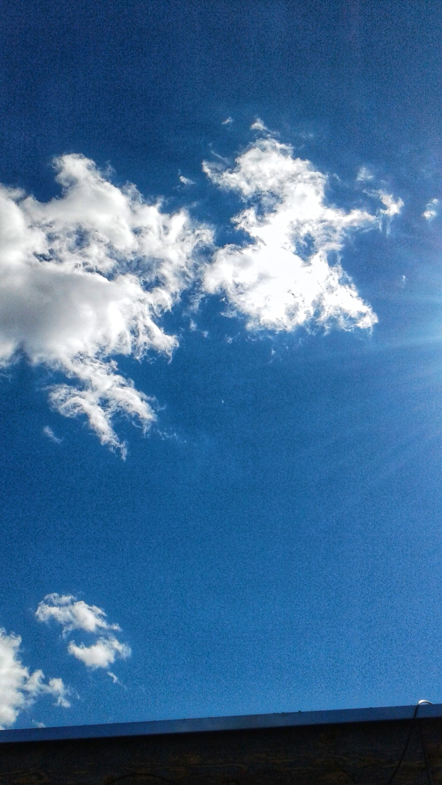 sky, cloud - sky, blue, low angle view, beauty in nature, tranquility, nature, tranquil scene, day, scenics, no people, outdoors