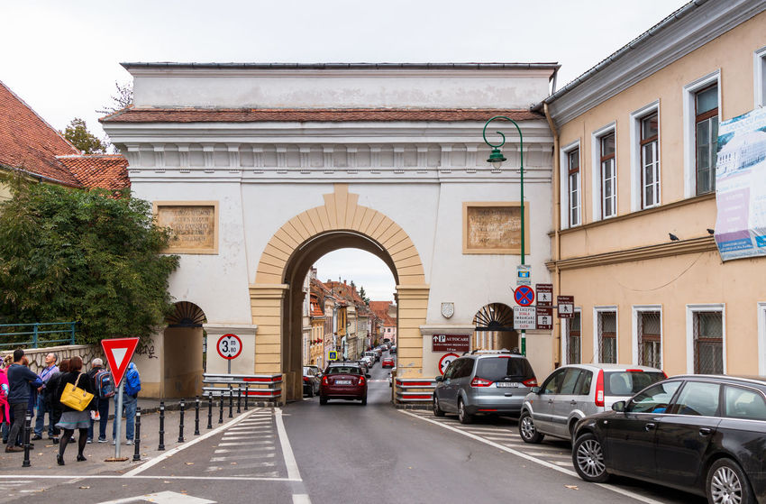 Brasov, Romania, October 06, 2017 : The Shay Gate (Poarta Schei), consisting of three arches, standing on the Gateway Schei Street (Strada Poarta Schei) in the Brasov city in Romania City Gateway Schei Street Place Poarta Schei Romania Shay Gate Strada Poarta Schei Transylvania Travel Architecture Brasov Building Exterior Built Structure City Day Europe Famous Place Heritage Historic Old Outdoors Street Three Arches Tourism Urban