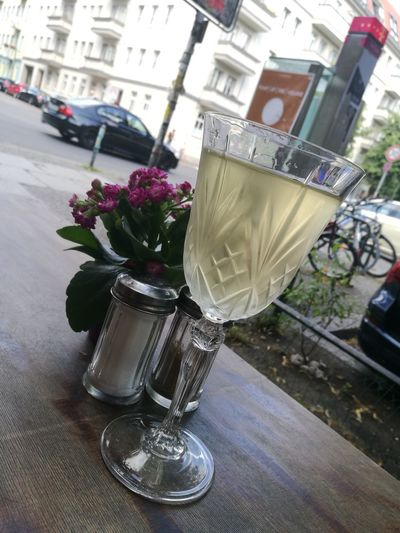 A Glass Of Wine Flower Table Built Structure Flower Head Day The Week On Eyem Best EyeEm Shot Berlin Photography Friedrichshain Beauty In Nature Home Is Where My Heart Is Architecture City Close-up Outdoors Salt And Pepper Car Berlin