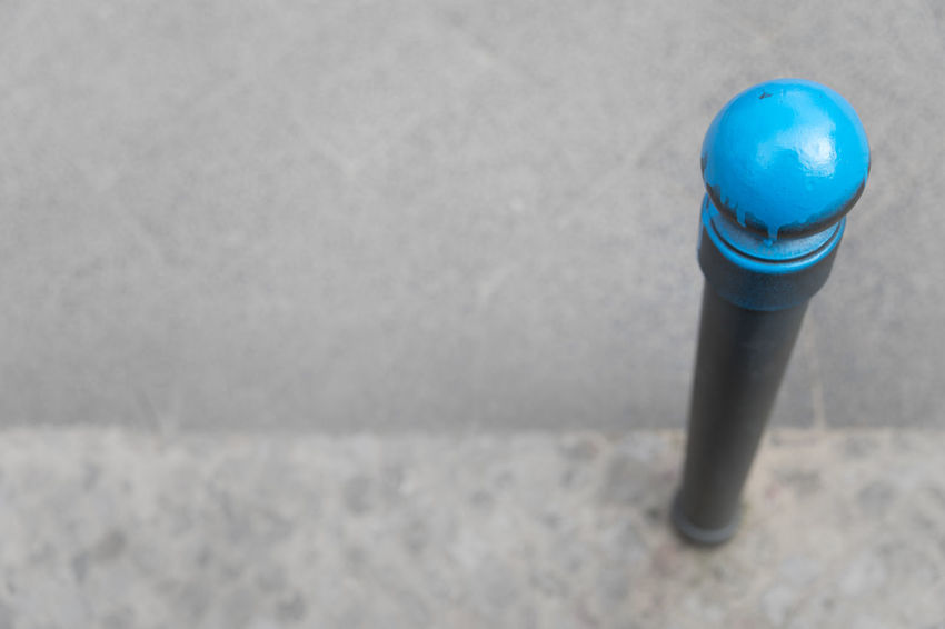 High angle view of blue colored bollard against grey background Boundary City Copy Space Footpath Paint Pedestrian Walkway Sidewalk Sphere Textured  Above Blue Bollard Close-up Concrete Gray Gray Background High Angle View Isolated Color Man Made Structure Paving Stone Protection Selective Focus Simplicity Single Object Street