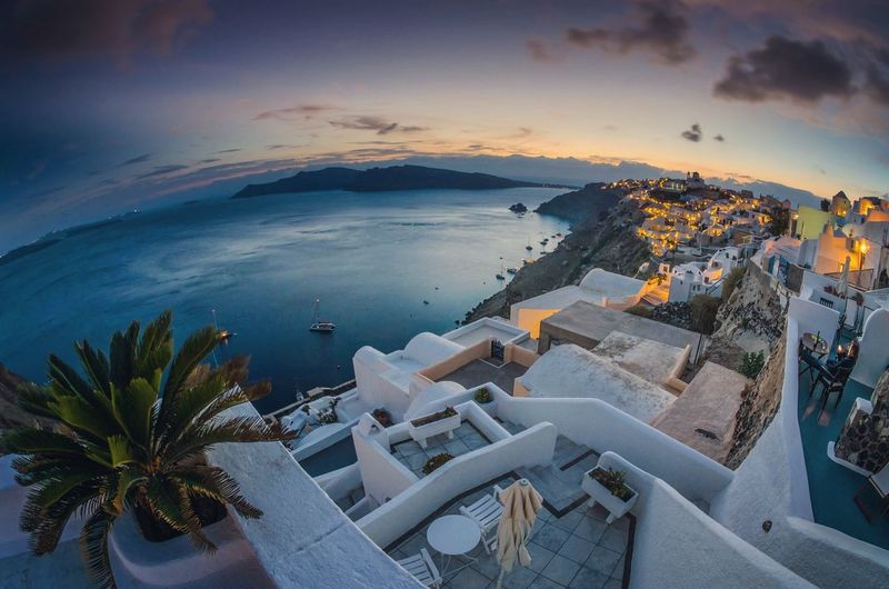 High angle view of buildings by sea during sunset at santorini