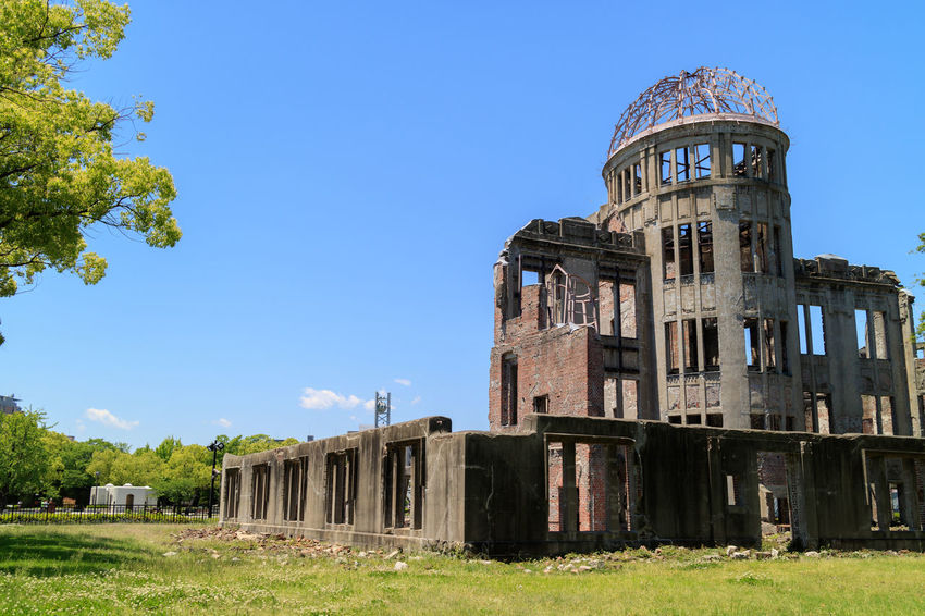 Atomic Bomb Dome, Hiroshima-shi, Japan. A-Bomb Dome Atomic Bomb Dome Hiroshima Atomic Bomb Dome Hiroshima Peace Memorial Park Hiroshima-shi Japan Japanese  Japanese History Ruins World War 2 Architecture Building Exterior Built Structure Clear Sky Day Grass Hiroshima Historic History No People Nuclear Bomb Outdoors Rural Scene Sky War