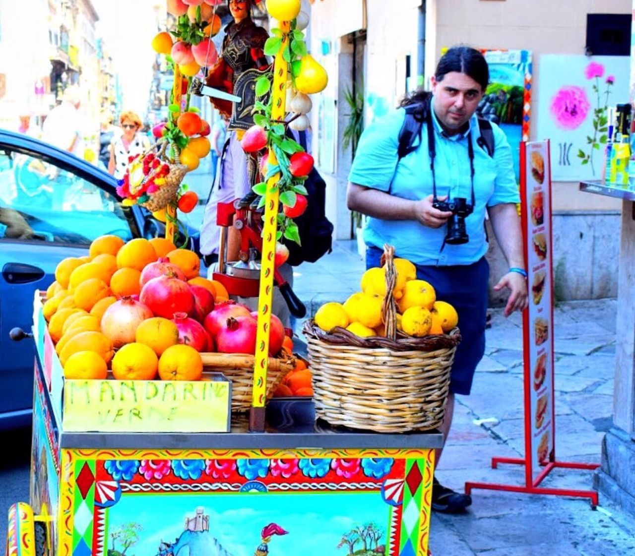 fruit, retail, market stall, small business, selling, real people, market, for sale, market vendor, food and drink, food, one person, day, outdoors, freshness, business, healthy eating, multi colored, occupation, working, supermarket, people