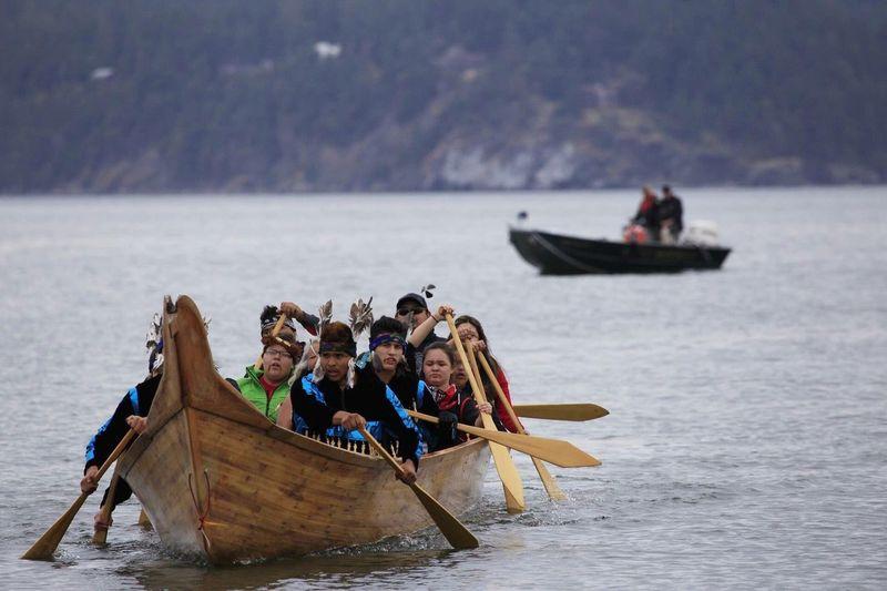 Lummi youth canoe paddle to protest