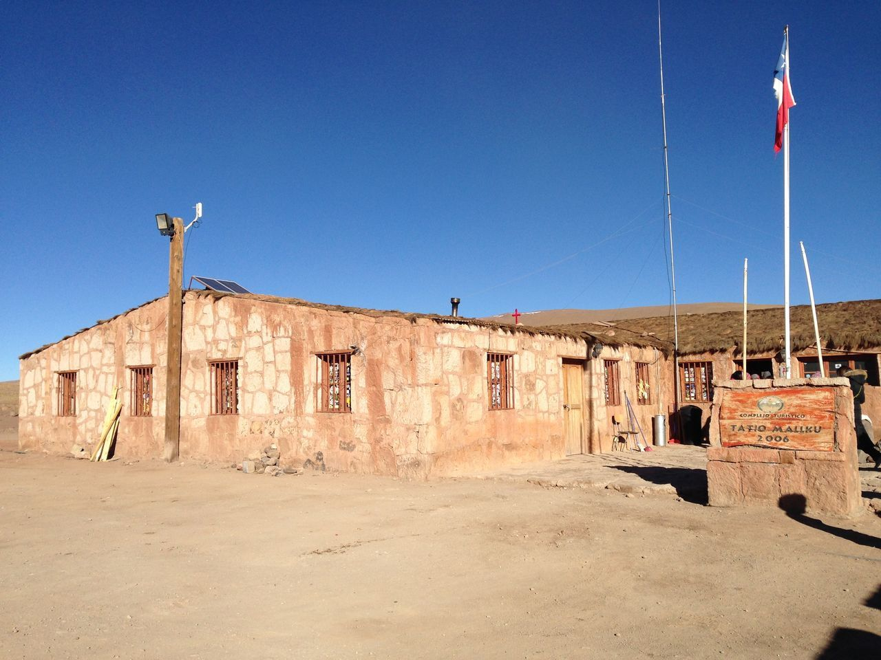 Old Church On Field At El Tatio Against Clear Blue Sky