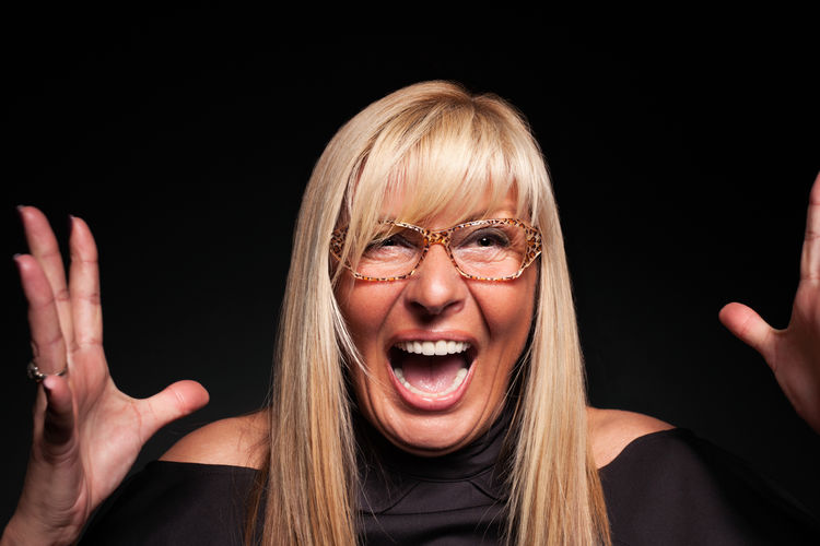 Mature woman screaming hysterically Black Background Blond Hair Blonde Business Business Finance And Industry Competition Control Eyeglasses  Glasses Lady Mature Adult Mature Women Middle-aged One Person Panic People Person Scream Shock Stress Studio Shot Suprise Woman Woman Portrait Work The Week On EyeEm The Portraitist - 2018 EyeEm Awards