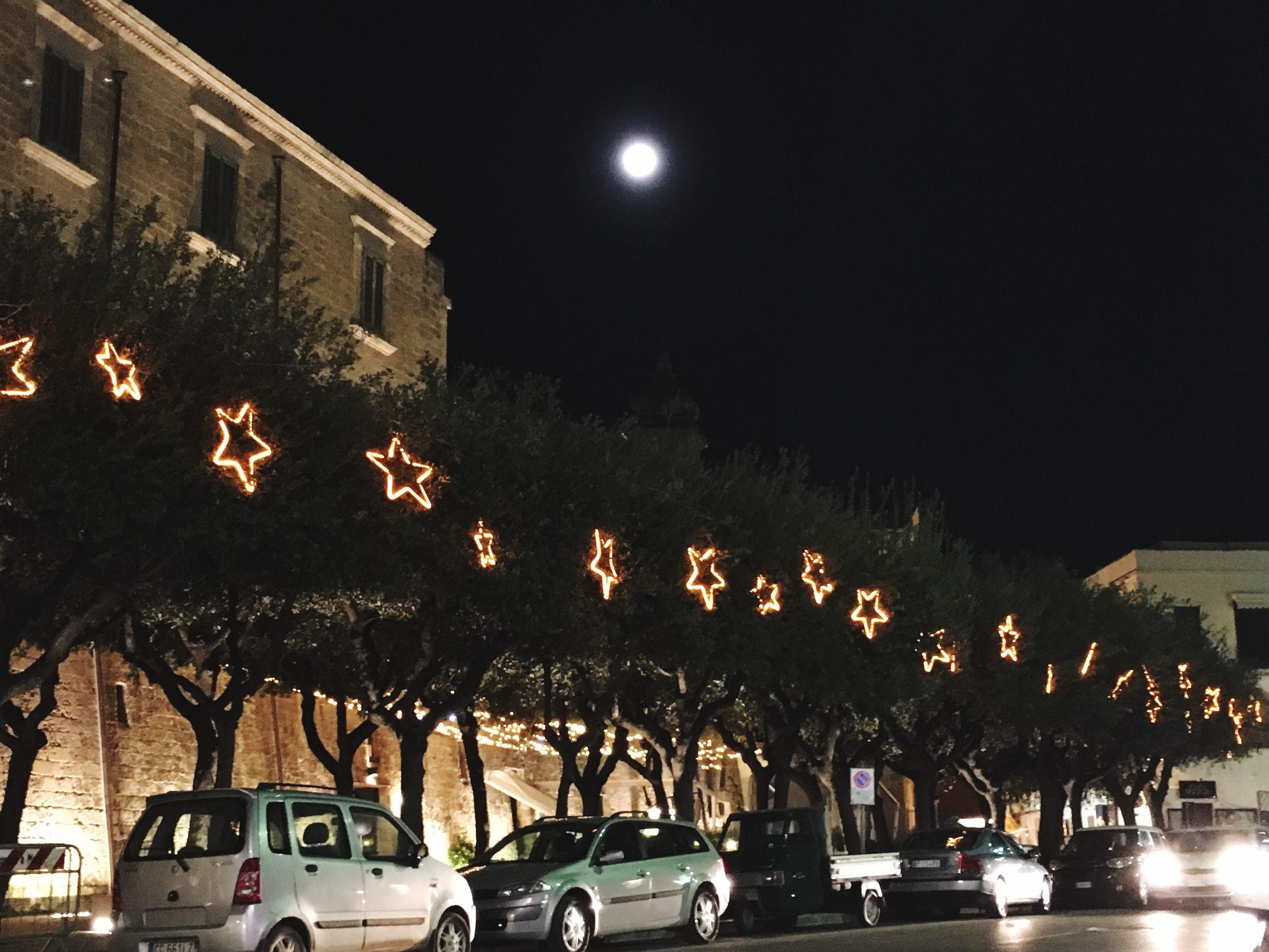 night, moon, illuminated, city, mode of transport, transportation, sky, tree, outdoors, no people