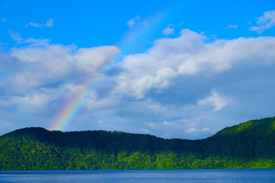 Rainbow in the sky. Shikotsu Lake, Hokkaido, Japan. Beauty In Nature Blue Cloud - Sky Day Fujifilm Fujifilm_xseries Hokkaido Japan Lake Landscape Mountain Nature No People Outdoors Rainbow Scenics Shikotsu Lake Sky Tranquility Tree Water