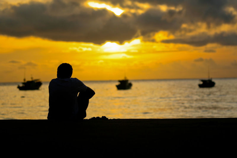 Sunrise at Tioman Island, Pahang, Malaysia Beauty In Nature Boats Horizon Over Water Island M Nature One Person Outdoors Rear View Scenics Sea Silhouette Sitting Sky Sunrise Sunset Tranquil Scene Tranquility Travel Destinations Traveling Water Yacht Long Goodbye Long Goodbye TCPM