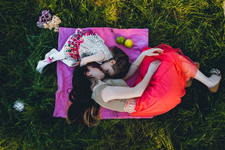 Portrait Of Mother And Daughter On Grassy Field