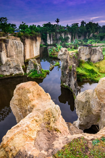 A sandy tuff like rock formation, local called it Godzilla's Cage Godzilla INDONESIA Tangerang Architecture Beauty In Nature Day Eroded Nature No People Outdoors Physical Geography Plant Reflection Rock Rock - Object Rock Formation Scenics - Nature Sky Solid Sunrise Tourism Tranquil Scene Tranquility Travel Destinations Water