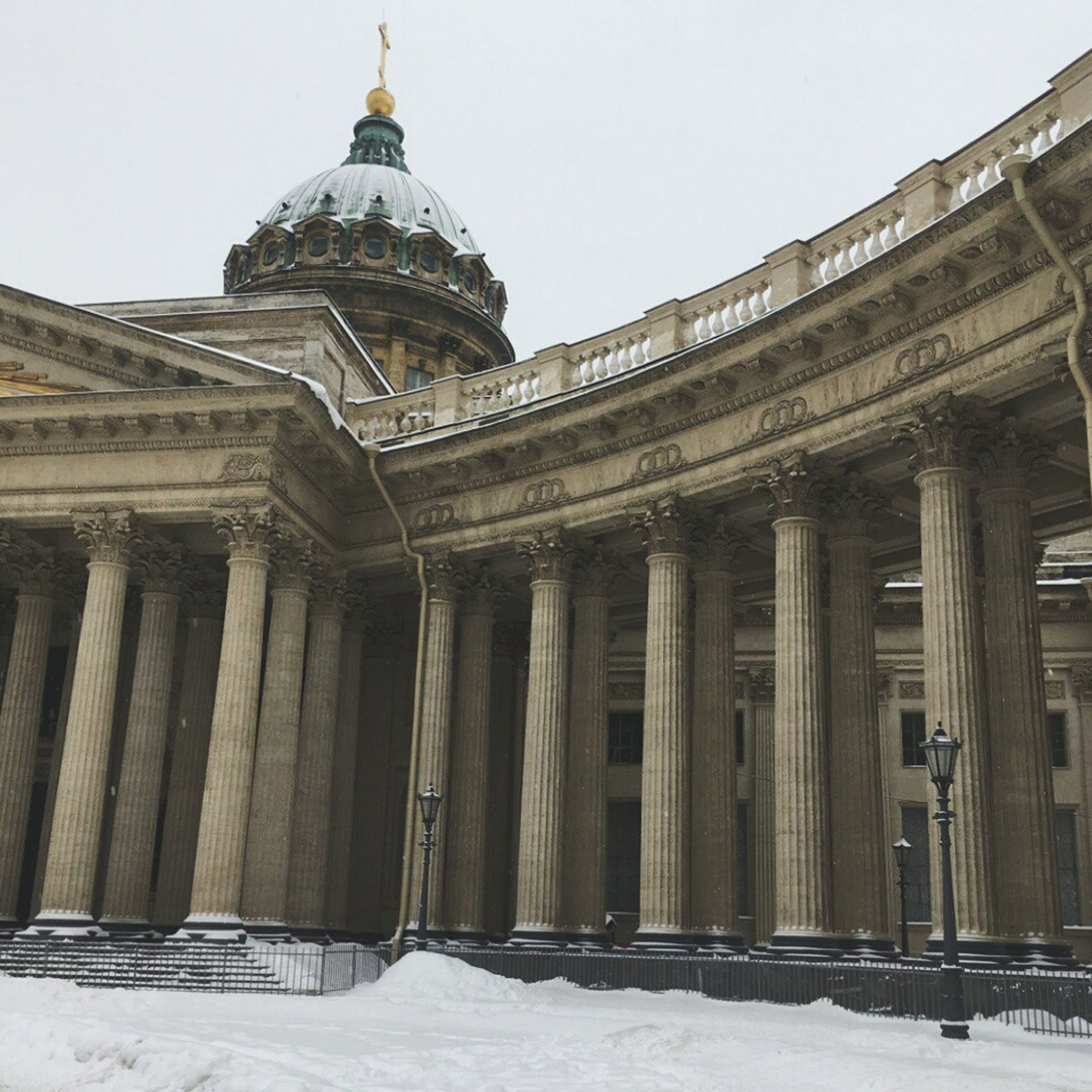 architecture, built structure, building exterior, architectural column, travel destinations, snow, outdoors, history, religion, city, place of worship, day, no people, sky, cold temperature, pediment