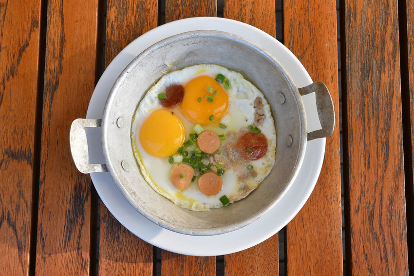 Eggs and sausages in a pan Breakfast Hot Plate Khao Yai Sausages Thailand Eggs Food High Angle View Plate Table Yoke