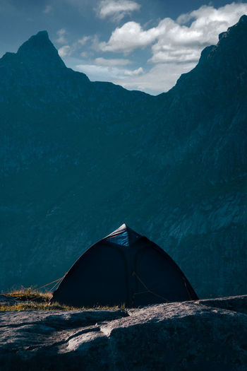Tent on the mountain ridge above Ramberg, Norway lit by the midnight sun and looking onto the sea, lofoten of Norway Lofoten Norway Lofoten Islands Norway Ramberg Scandinavia Travel Travel Photography Beach Beauty In Nature Day Independent  Landscape Lifestyles Lofoten Mountain Mountain Range Nature No People Outdoors Scenics Sky Tent Tranquility Traveler Water