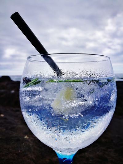 Close-up of cocktail against cloudy sky