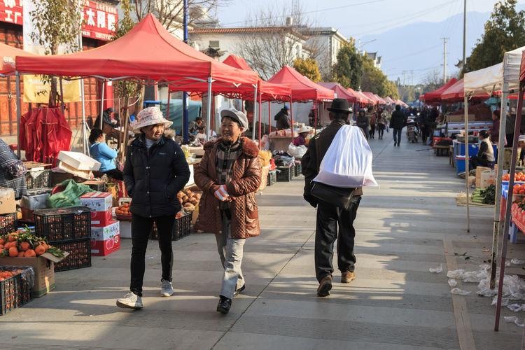Shaxi, China - February 22, 2019: Chinese women in the Friday market in Shaxi old town Shaxi Yunnan Yunnan ,China Kunming, China Market Horse Horses South Silk Road