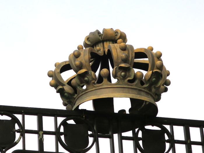 crown on a gate of the zoo in Antwerp Crown Gate Architecture Clear Sky Close-up Day Fence Focus On Foreground Metal No People Outdoors Shape Sky Symbol White Background Wrought Iron Zoo Antwerpen