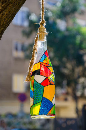 Bottle art #1 Architecture Art And Craft Belief Built Structure Close-up Craft Creativity Day Decoration Focus On Foreground Hanging Multi Colored Nature No People Outdoors Pole Religion Tree