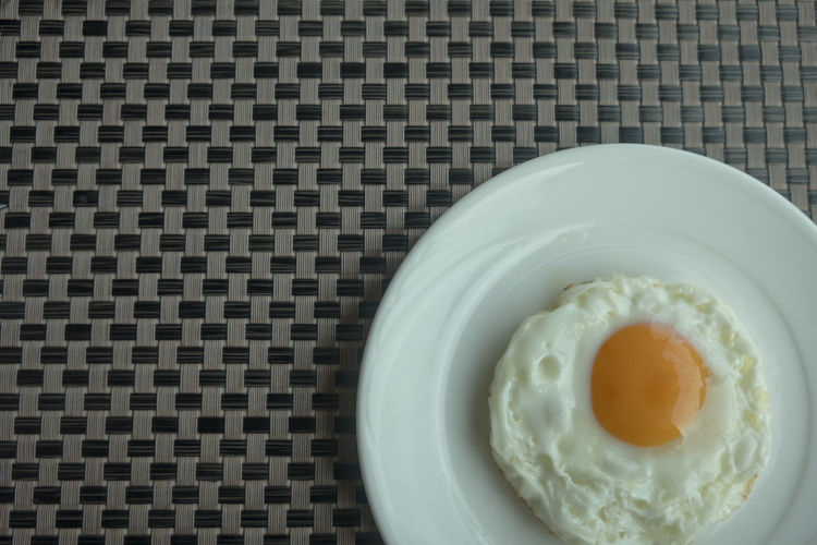 Egg Food And Drink Indoors  Food Freshness Directly Above Egg Yolk Close-up No People Ready-to-eat Table Fried Egg Healthy Eating High Angle View Meal Indulgence