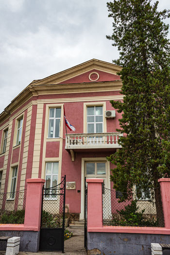 Streets in Pirot Flag Serbian Pirot Built Structure Building Serbia Pink Serbian Architecture Serbian School Architecture Pine Tree Tree School Public Building Serbian Flag Fence Building Exterior Sky Plant Cloud - Sky Nature Window Low Angle View Day No People Residential District Outdoors Red Railing House City Staircase The Architect - 2019 EyeEm Awards