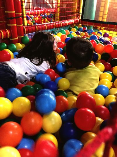 Ludoteca Bambini  Palline Ludoteca  Multi Colored Childhood Child Real People Leisure Activity Indoors  Large Group Of Objects Choice Toy Two People Casual Clothing Togetherness Boys Females Lifestyles
