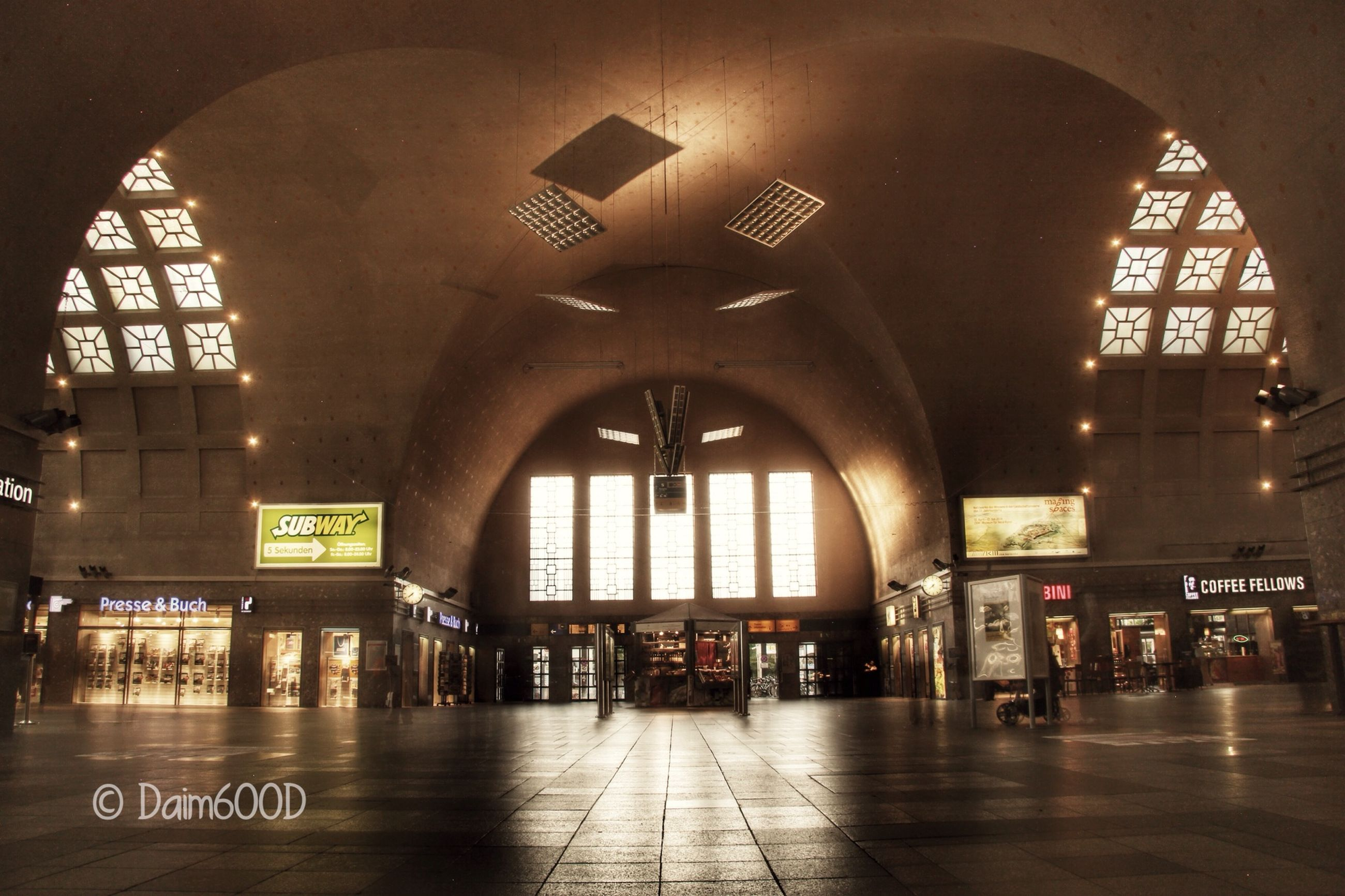 architecture, built structure, arch, building exterior, illuminated, indoors, city, text, travel, famous place, clock, travel destinations, incidental people, capital cities, railroad station, interior, transportation, communication, tourism, low angle view