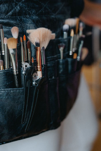 Close-up of make-up brush in pocket