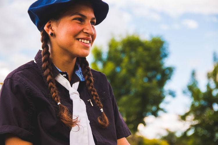 Side view of smiling teenage girl wearing beret