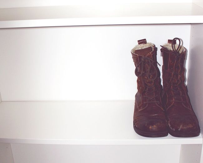 Close-up of shoes on shelf at home
