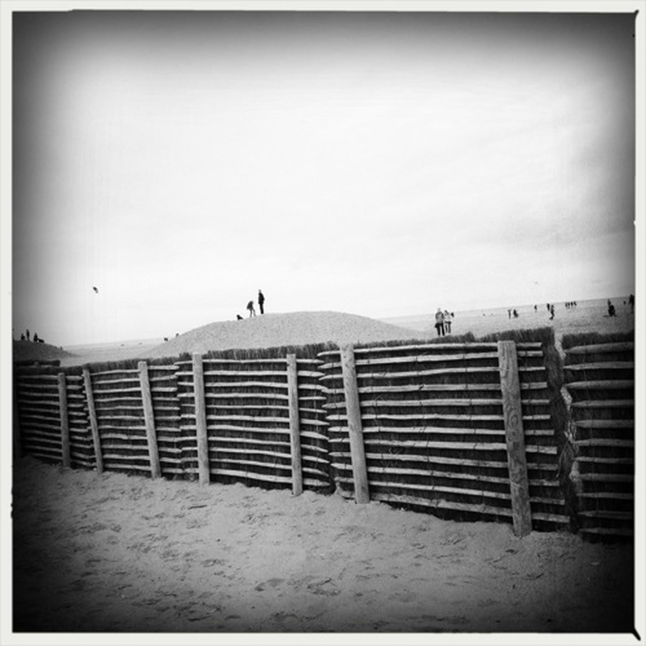 transfer print, auto post production filter, railing, copy space, clear sky, men, sky, walking, full length, day, leisure activity, fence, beach, outdoors, lifestyles, steps, nature, built structure