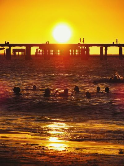 Reflexos de um dia feliz Sunset Sun Bridge - Man Made Structure Orange Color Sunlight Water Travel Destinations Outdoors Sea Built Structure Sky Silhouette Nature Beach Horizon Over Water Beauty In Nature Tranquility Photography Vacations Beauty In Nature