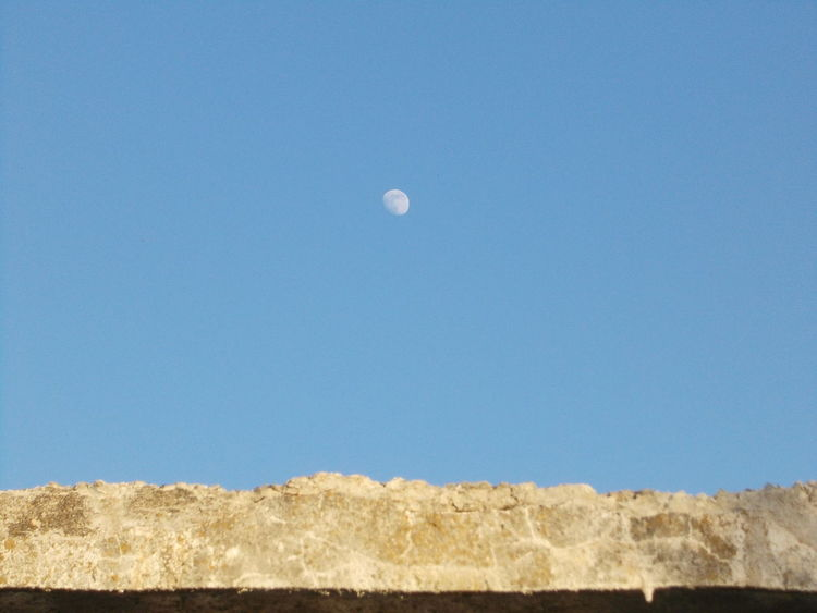 Moon over abandoned building Abandoned Building Abandoned Buildings Abandoned But Not Forgoten Beauty In Nature Blue Burgas, Bulgaria Bułgaria Clear Sky High Section Low Angle View Moon In Daylight Moon In Sky Moon In The Afternoon Moon In The Day Moon In The Sky Moon Over Abandoned Building Moon Rising Moon Shots Nature No People Outdoors Scenics Sky Tranquil Scene Tranquility