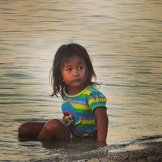 Little balinese girl chilling on the beach Bali Children Ilovebali ILoveAsia Balibible Balilove Travel Kids