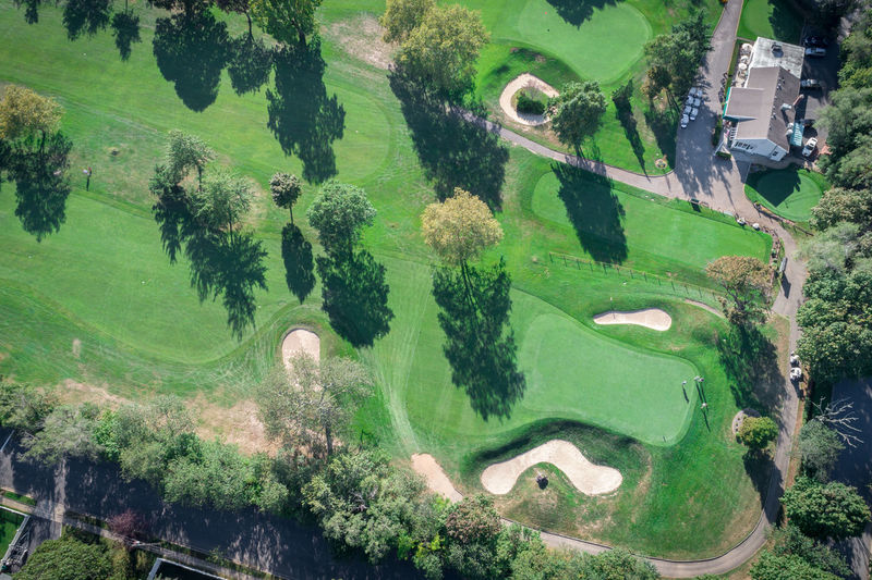 Aerial View Beauty In Nature Day Golf Golf Course Grass Green - Golf Course Green Color Growth Landscape Nature No People Outdoors Sand Trap Scenics Sport Tree