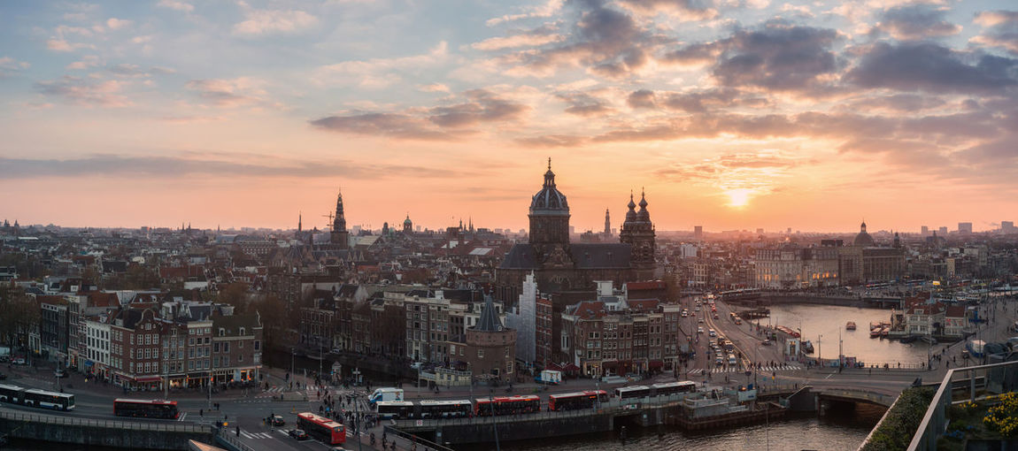 Aerial view Amsterdam skyline Built Structure Architecture Building Exterior City Sky Sunset Cityscape Cloud - Sky Building Travel Destinations No People Travel Place Of Worship Tourism Outdoors Amsterdam Netherlands Holland Capital Cities  Aerial View High Angle View Skyline