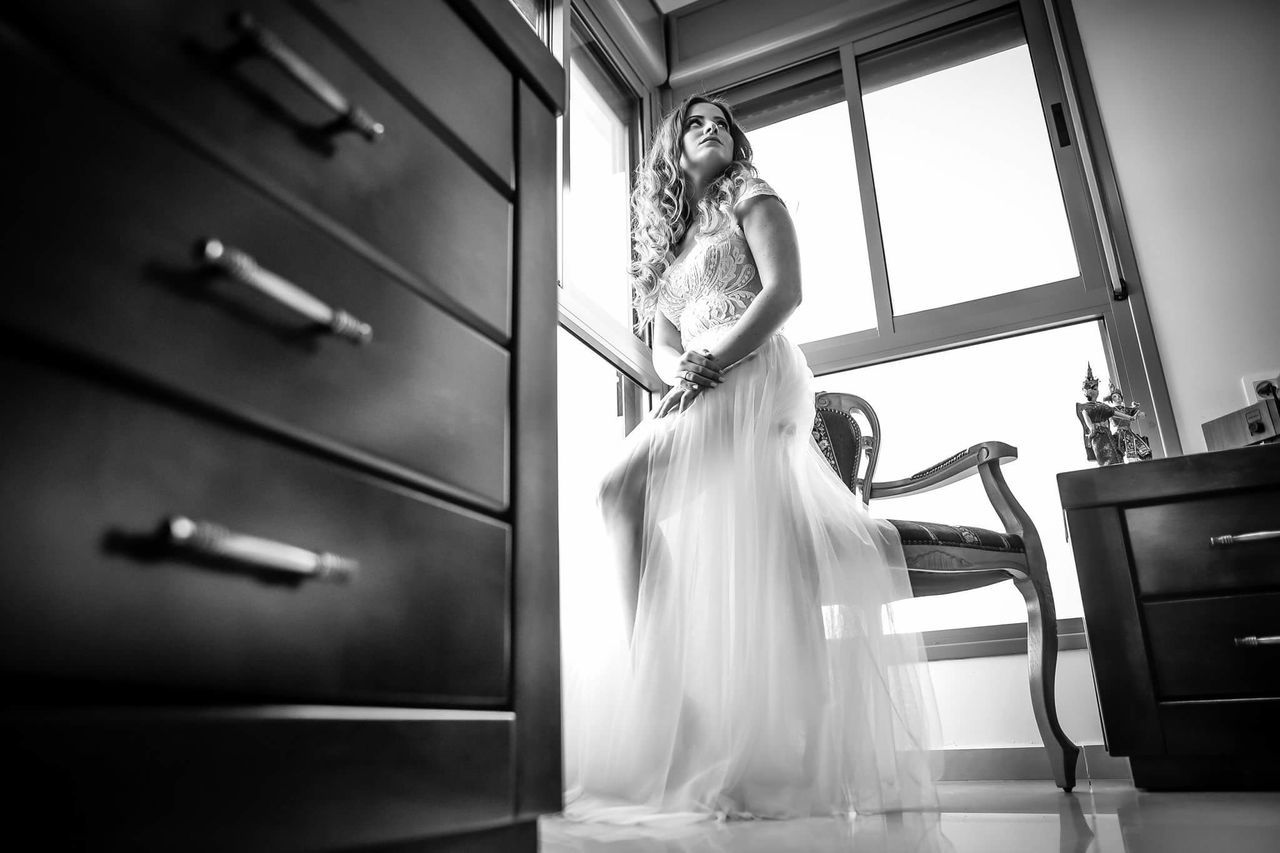 bride, wedding, wedding dress, indoors, real people, young adult, young women, full length, standing, women, one person, life events, beautiful woman, day, one young woman only, adult, people