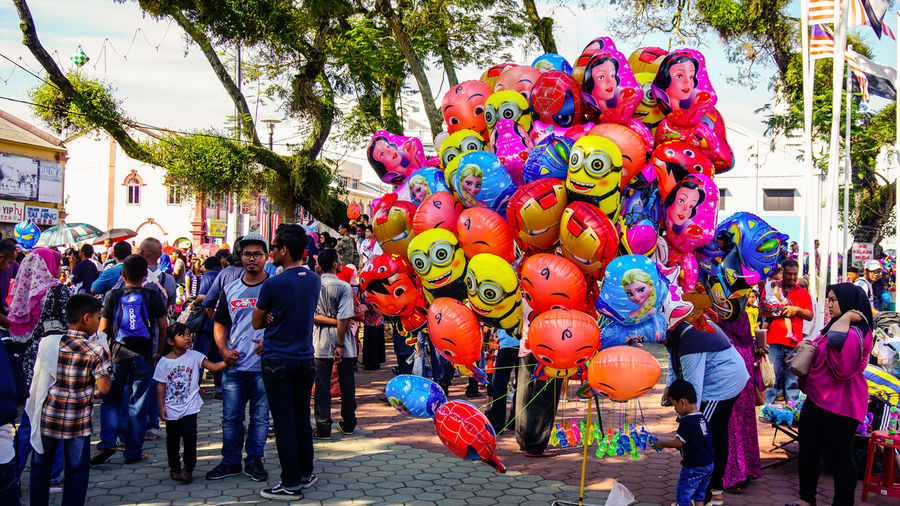 Kuantan, Malaysia – August 2017 : A balloon cartoon is a popular product in any festival at Malaysia. Carnival Celebration Event Fun Gas Happiness Happy Superhero Anniversary Balloon Bunch Cartoon Crowd Decoration Editorial  Fest Helium Balloon Job Large Group Of People Outdoors Park Party People Sell Streetphotography