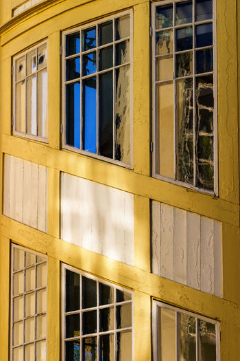Low angle view of yellow windows on building