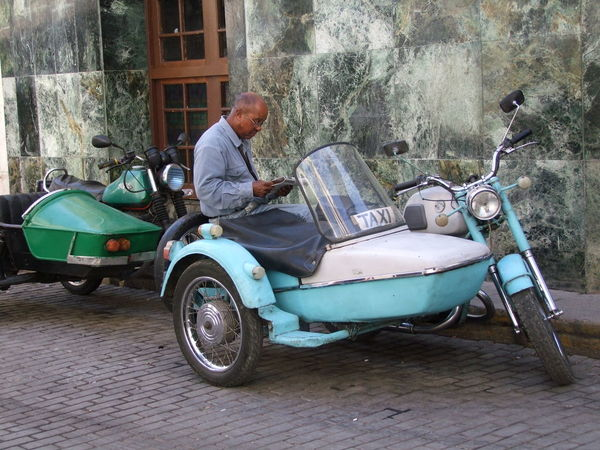 Motorcycle & Sidecar Taxi Blue And White Casual Clothing Composition Cuba Full Frame Havana Land Vehicle Lifestyles Man Mode Of Transport Motorcycle Newspaper No Incidental People Outdoor Photography Parked Reading Side View Sidecar Stationary Street Taxi Tourist Attraction  Tourist Destination Waiting