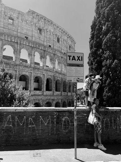 Woman against historic building