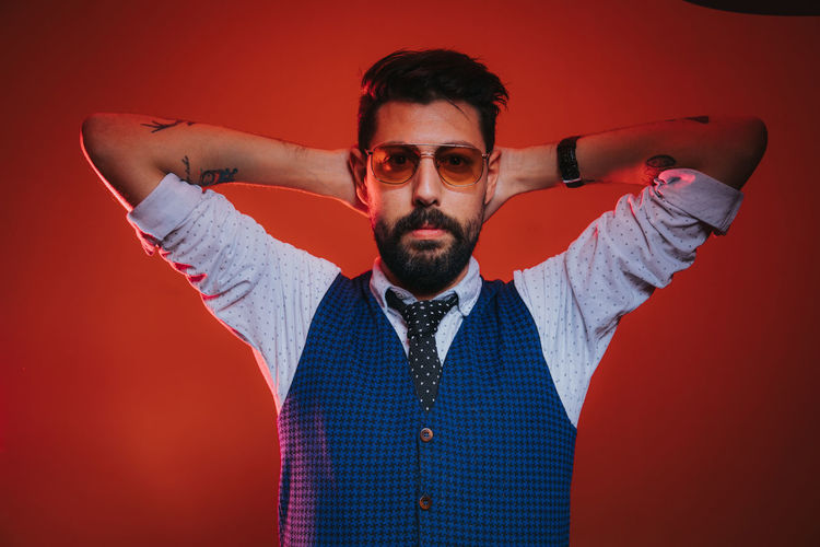 One Young Man Only One Man Only Young Adult Only Men Human Body Part Portrait Human Arm Looking At Camera Adult One Person Human Hand Fashion Handsome Colored Background Studio Shot Red Young Men People Day Adults Only
