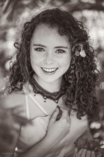 Beautiful Woman Blackandwhite Close-up Curly Hair Flower In Hand Looking At Camera Necklace Smiling