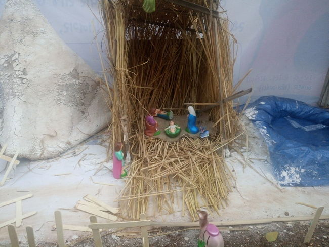 Bird Nest Christmas Collection Commercial Fishing Net Crib Day Fishing Net Lifestyles Merry Christmas Merry Christmas Eve! Merry Christmas! Nativity Church Nativity Figurine Nativity Scene One Person Outdoors People Real People Sky Traveling Home For The Holidays Tree Women Working