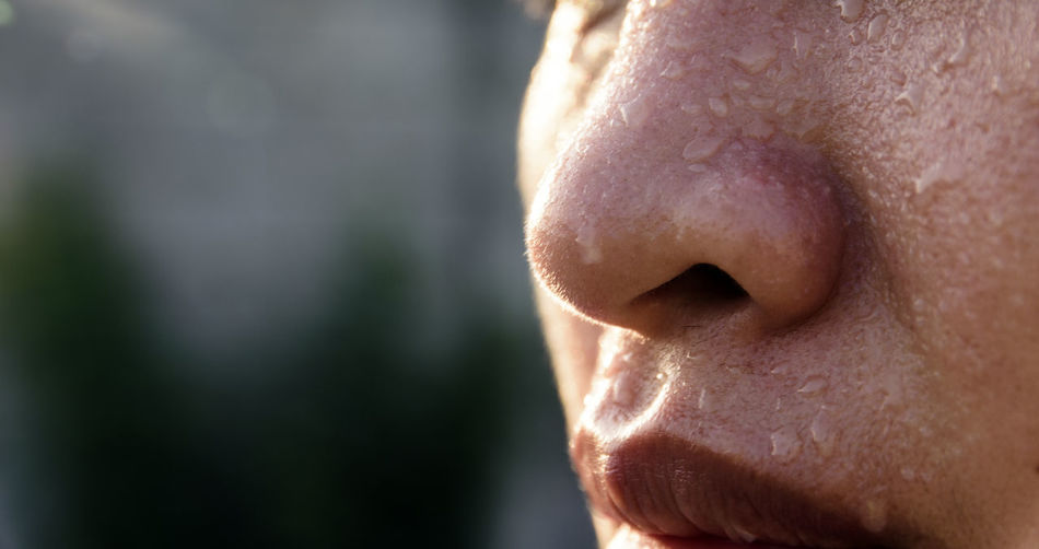 Sweating on face of asian women Adult Body Part Close-up Contemplation Day Focus On Foreground Headshot Human Body Part Human Face Human Hair Human Lips Human Mouth Human Nose Human Skin Men Mouth Open One Person Outdoors Portrait Profile View Real People Skin