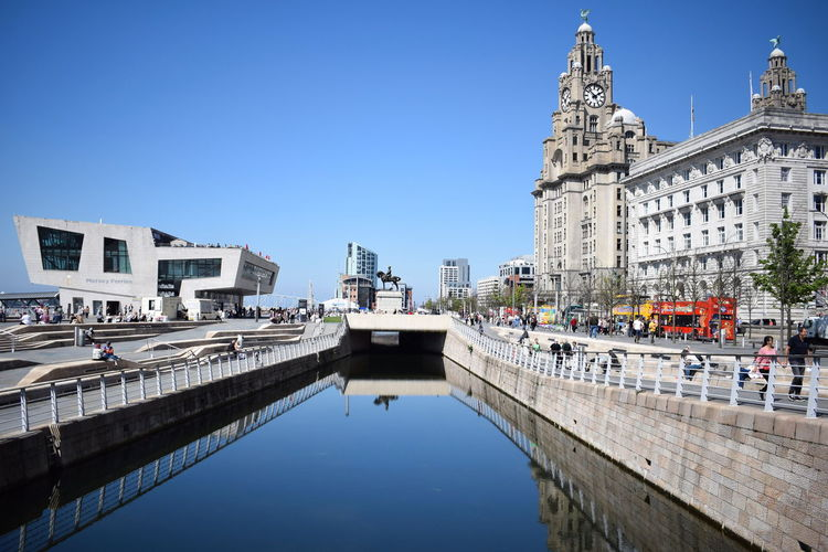 Liverpool Modern Architecture Old Vs New Architecture Blue Sky Bridge Bridge - Man Made Structure Building Building Exterior Built Structure Canal City Clear Sky Day Nature Outdoors Reflection Sky Tourism Transportation Travel Travel Destinations Uk Water Waterfront British Culture