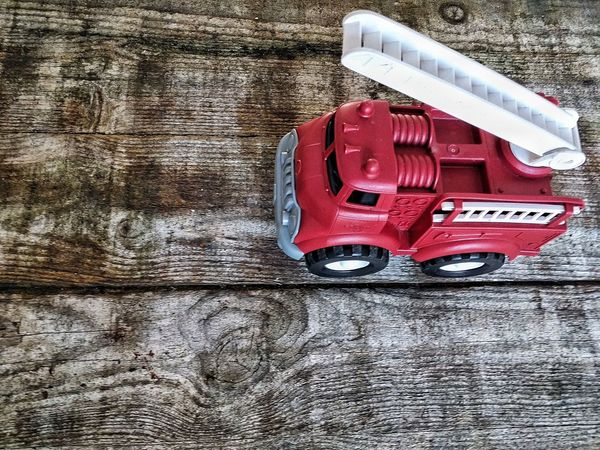 Kid's Life Kid's Play Kid's Toys Kid's Table Kid's Point Of View... Toy Truck Firetruck Kid's Firetruck Toy Car Toycommunity Toy Tractor Toy Photography Toyphotography Red Fresh On Eyeem  Hello World Color Red Wooden Table Old Wooden Table Toy Weathered Wood Toys Ladder Wagon Firebrigade Fireengine End Plastic Pollution
